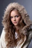 Image of enchanting young girl posing in fur hood — Stock Photo