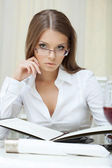 Portrait of pensive business woman in glasses — Stock Photo