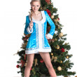 Snow Maiden posing with Christmas tree and gifts — Stock Photo #30559353