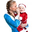 Cheerful mother and baby posing in fancy costumes — Stock Photo