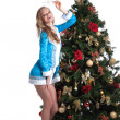 Graceful Snow Maiden posing with decorated fir — Stock Photo