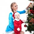 Smiling mother and baby posing in Xmas costumes — Stock Photo #30631871