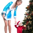 Merry mother-Snow Maiden keeps baby-Santa Claus — Stock Photo