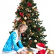 Snow Maiden and baby-Santa with Christmas tree — Stock Photo