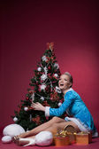 Happy Snow Maiden posing with Christmas tree — Stock Photo