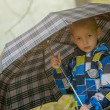Pretty little boy posing under umbrella, close-up — Stock Photo