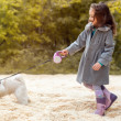Image of little fashionista walking with dog — Stock Photo