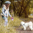 Image of pretty little girl playing with cute dog — Stock Photo