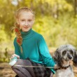 Cute smiling freckled girl posing with dog — Stock Photo