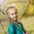 Smiling freckled girl posing with umbrella — Stock Photo