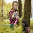 Beautiful little girl holding cute puppy — Stock Photo