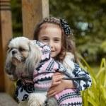 Portrait of adorable little girl hugging pet — Stock Photo