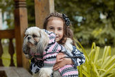 Portrait of adorable little girl hugging pet — Stock Photo