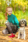 Adorable little girl posing with dog outdoors — Stock Photo