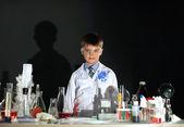Cute little boy posing as scientist in lab — Stockfoto