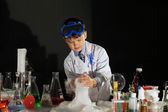 Image of little scientist watching experiment — Stock Photo