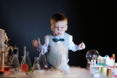 Focused little experimenter posing in studio — Stock Photo