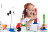 Image of surprised little experimenter in studio — Stock Photo
