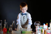 Young physicist experimenting with the reagents — Stock Photo