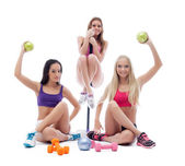 Funny sportswomen posing with sports equipment — Stock Photo