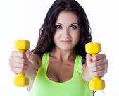 Portrait of smiling sporty woman with dumbbells — Foto Stock