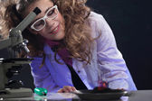 Smiling young physicist conducting experiment — Stock Photo