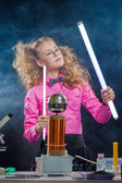 Image of ingenious girl conducting experiment — Stock Photo