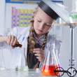 Adorable little girl conducting an experiment — Stock Photo