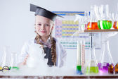 Smiling cute naturalist conducting experiment — Stock Photo