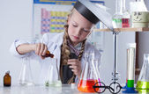 Adorable little girl conducting an experiment — Foto de Stock