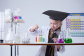 Image of smart little girl mixes reagents in lab — Stock Photo
