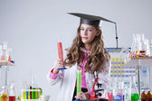 Pretty high school student conducting experiment — Stock Photo