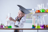 Educated girl following experimental results — Stock Photo