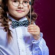 Stock Photo: Portrait of lovely little girl posing with glasses