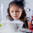 Pretty girl looking at reagent's vaporization — Stock Photo