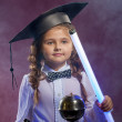 Stock Photo: Charming little girl posing with lamp in lab