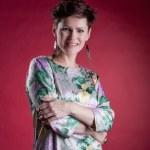 Portrait of pretty woman posing in flowered dress — Stock Photo