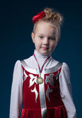 Pretty little sporty girl posing with medal — Stock Photo