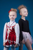 Portrait of sporty little girls posing in studio — 图库照片
