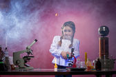 Studio shot of startled little girl in laboratory — Stok fotoğraf