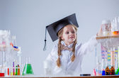 Adorable little girl conducting experiment in lab — Stock Photo