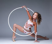 Image of elegant young gymnast dancing with hoop — Stock Photo