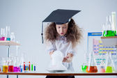 Curious girl watching result of experiment in lab — Stock Photo