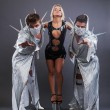 Stock Photo: Trio of go-go dancers in erotic costumes
