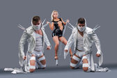 Sexy girl holding on chain strong guys in masks — Stock Photo