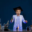Stock Photo: Very surprised boy conducting experiment in lab