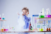 Curious boy watches chemical reaction of reagent — Stock Photo
