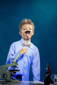 Image of funny boy fooling around in chemistry lab — Zdjęcie stockowe