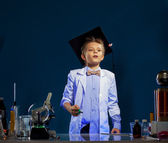 Inquisitive boy watching result of experiment — Stock Photo