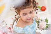 Cute elegant little brunette with downcast eyes — Stock Photo